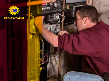A technician repairing a heating system